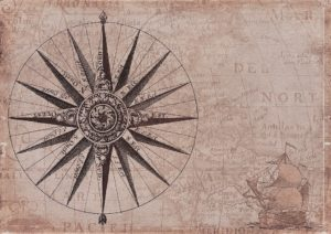 a map with a compass rose and a sailing ship